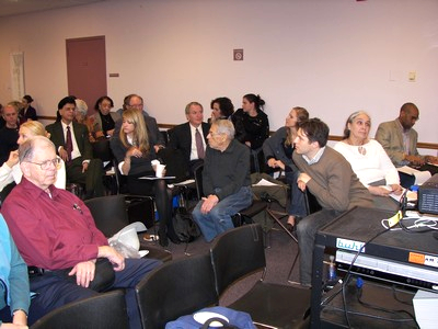 Symposium attendees listen with interest to the attendee questions