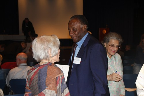 IGS Ambassador-at-Large Milton Dawes speaks with another attendee