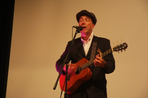 John Watts\'s music moves a number of the attendees to sing along with him